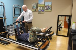 Arm work on the Pilates Reformer at Zang Physical Therapy